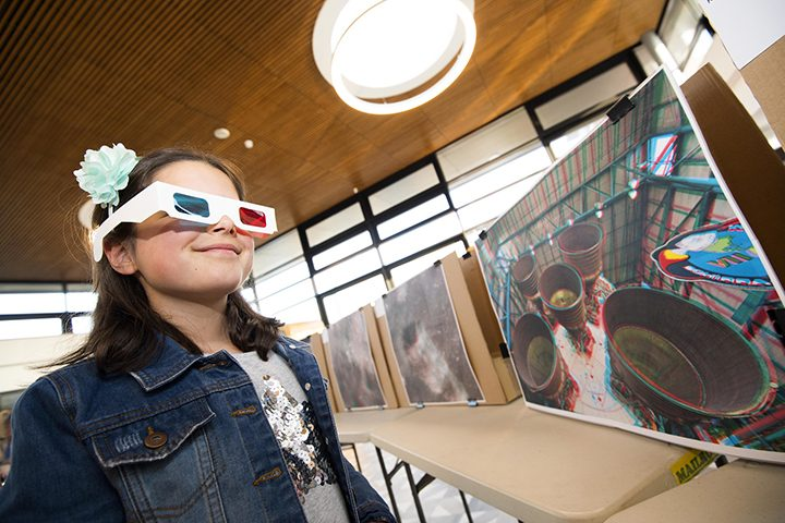 A young visitor enjoys the interactive displays at the moon landing anniversary event Pic: UCLan