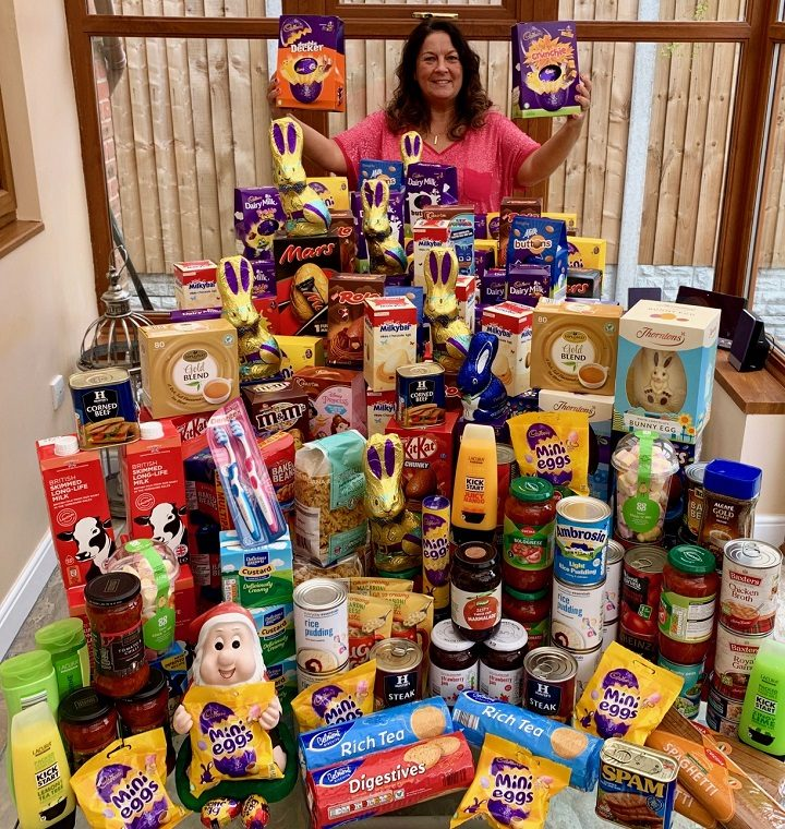 Deborah from Electricity North West's Preston depot with the donated goods and Easter Eggs