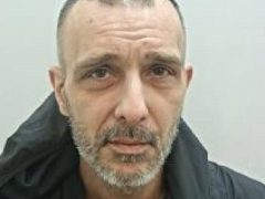Khan is wanted by police