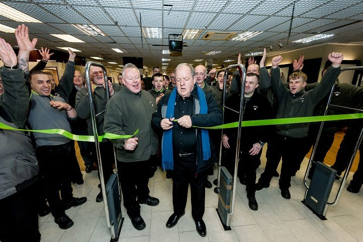 Actor and Emmaus ambassador John Henshaw cuts the ribbon at a new Emmaus opening in Rochdale