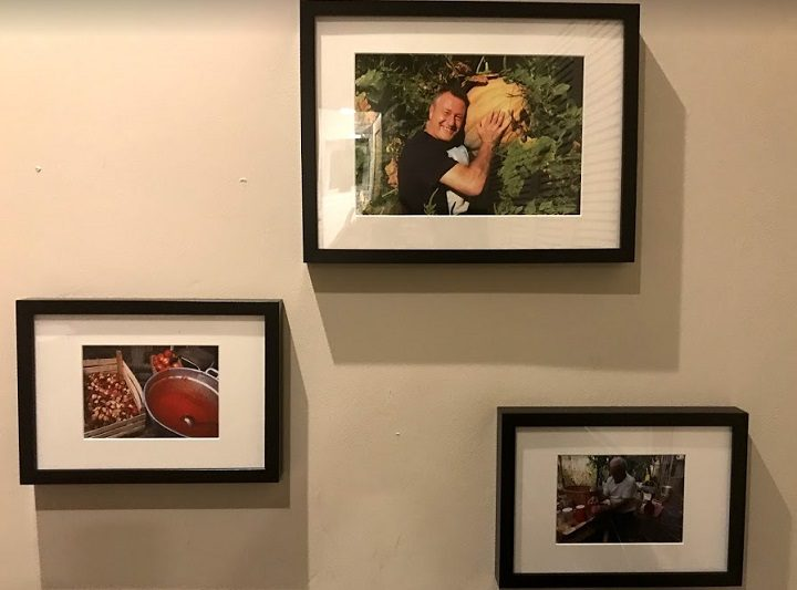 Photos adorn the walls, and include reminders of the popular restauranter