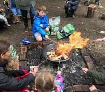 Toasting marshmallows at Diggy Sticksa