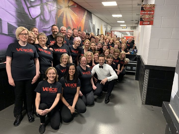 The One Voice Choir pose with Hugh Jackman backstage in Manchester Pic: One Voice Community Choir
