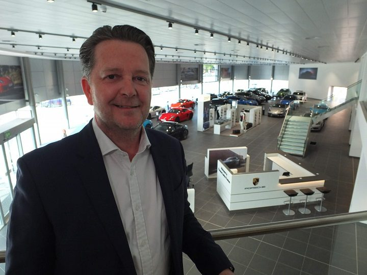 Paul Bowker with the new showroom behind