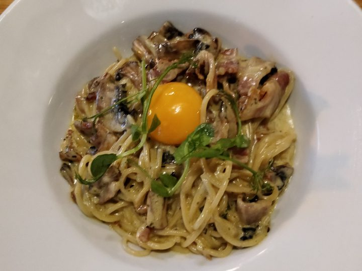 Note the raw egg atop the carbonara