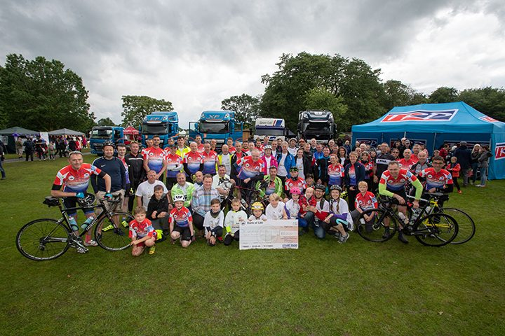 Representatives of the Factory to Festival ride pose with the £12k cheque donated to St Catherine's