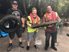 Residents Mark Felton, David Connors and Neil White with some of the objects pulled from the canal last year