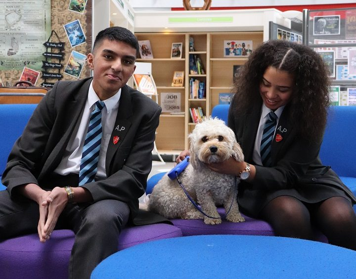 Biscuit with two of the Academy pupils