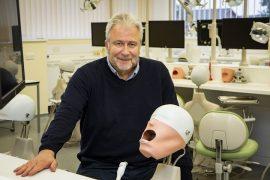 Richard Welbury with the 'phantom head' at UCLan dental school