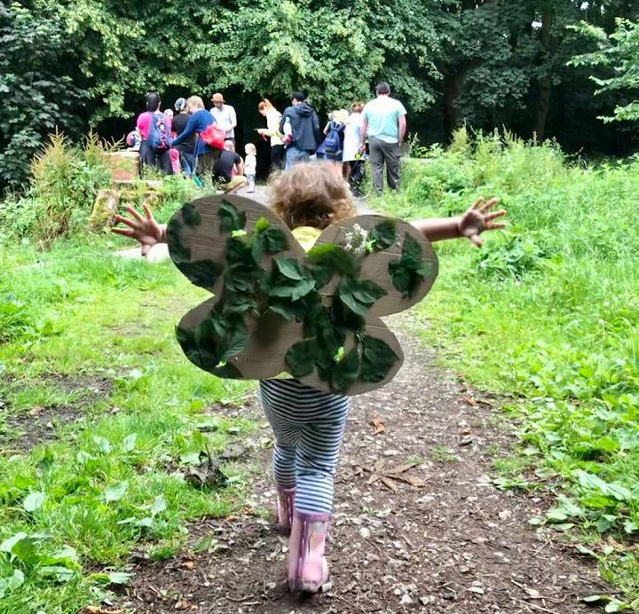 One child wears her fairy wings in the woods