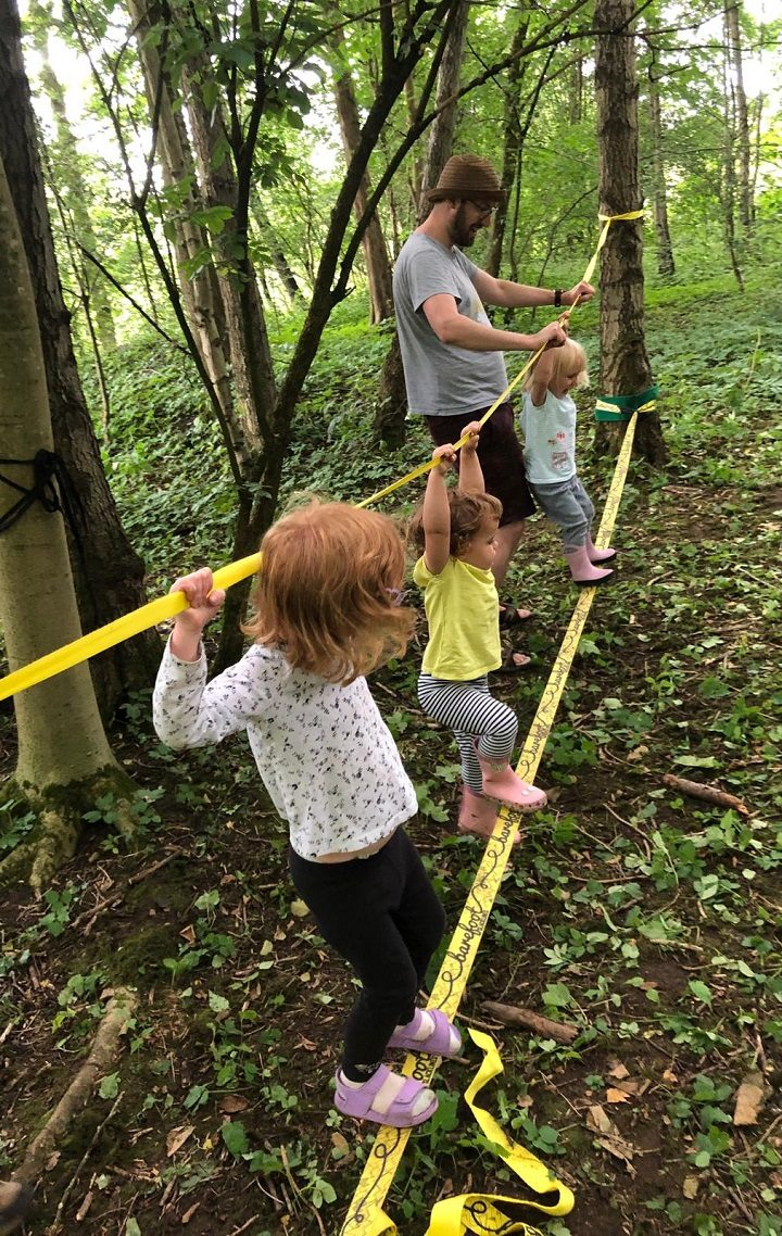 A group of little explorers taking on the slackline