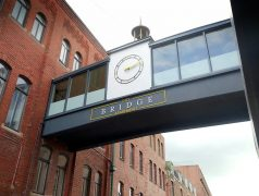 The former Booths bridge in Glover's Court with the City Bridge logo Pic: Tony Worrall