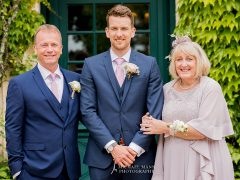 Ash with his parents Deborah and Philip on his wedding day