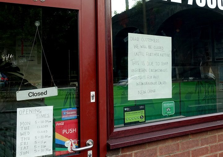Sign in the window of the New China Pic: Tony Worrall