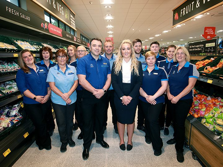 Store Manager Rob Alexander and Area Manager Jessica Burrows with team members at Aldi Fulwood, Preston