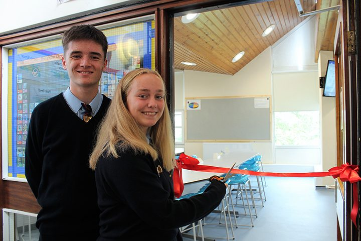 Two pupils cut the ribbon to open the new labs