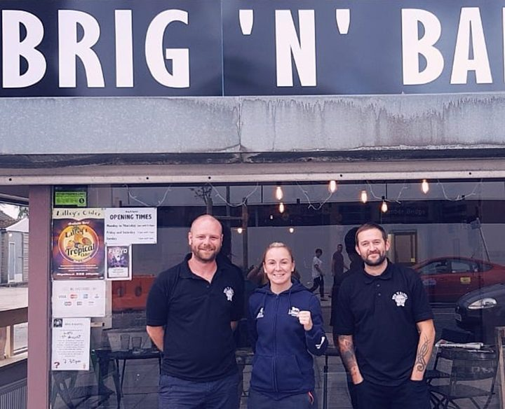 Graham (left) and Chris with pro boxer Lisa Whiteside on her first visit to Brig 'n' Barrel