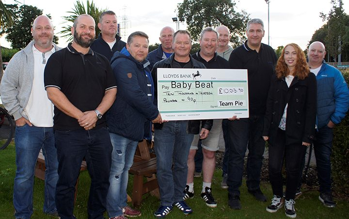 The group with the cheque for the Baby Beat Appeal