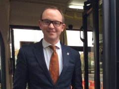 County Councillor Andrew Snowden on a bus
