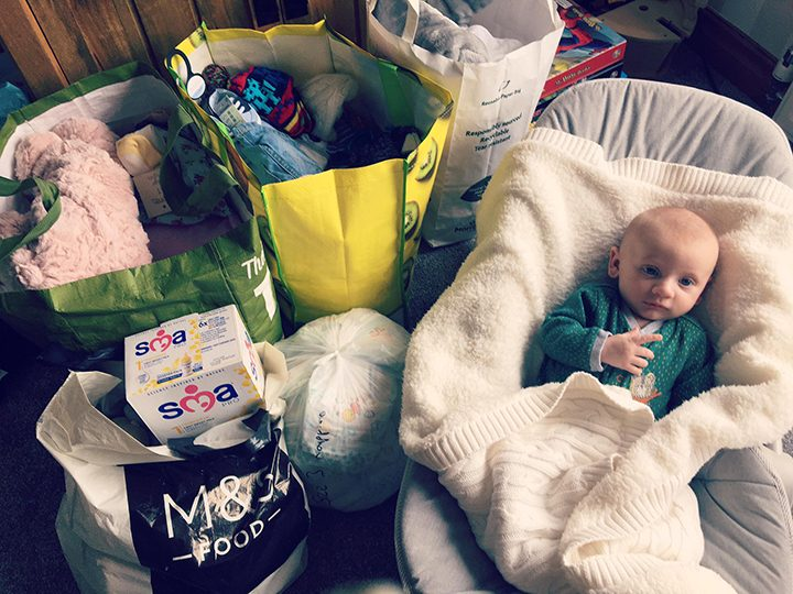 Jacqueline's baby with a selection of the donations