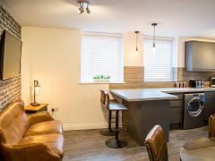 Kitchen/living/dining area in one of the show apartments