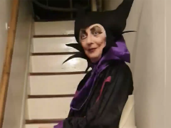 Yvonne on a stairlift dressed as Maleficent