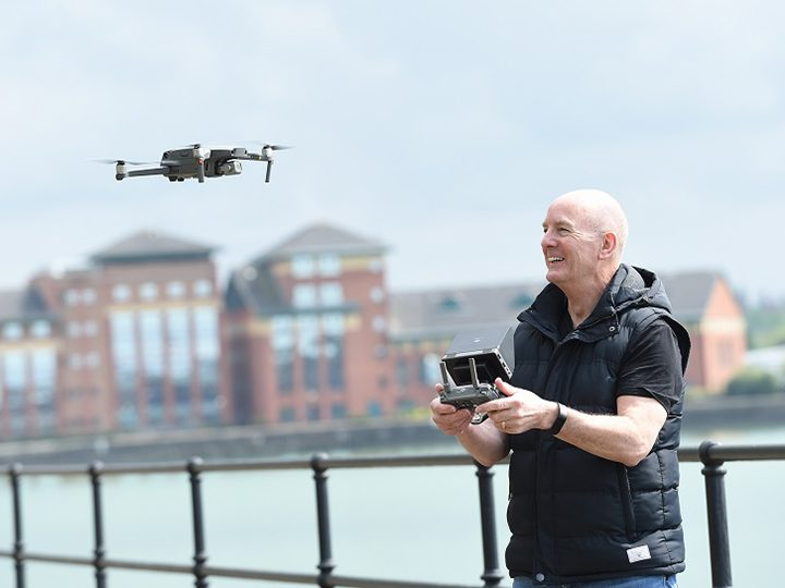 Paul operating a drone