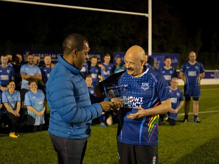 Andi Peters presenting Lawrence with his award