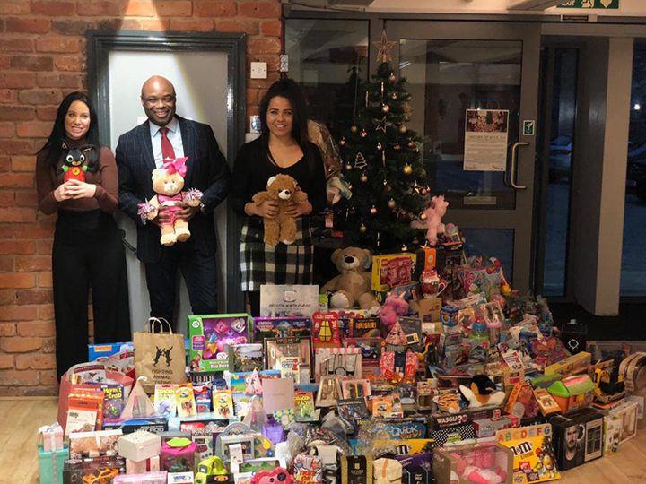 Amy, Rob and Rochelle with presents donated to last year's gift appeal