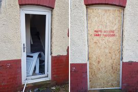 The door of the property has been boarded up after the raid