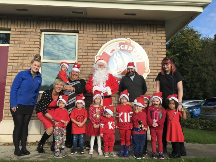 Getting cheeky with Santa are nursery manager Joanne Pierpoint (left) and nursery nurse Emma Reibbitt (far right) with children who attend Eric Wright Group's on-site nursery. Besides the man himself, also supporting the dash are, from the left, Rosemere Cancer Foundation's Rebecca Arestidou, Eric Wright Group's Suzanne Taylor and Alan Taylor, who is helping to organise the dash