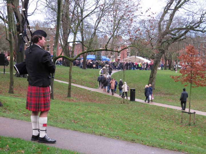 Bagpiper playing during last years Winkley Square Christmas Concert