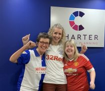 Rival footie fans, but joining together for a great cause - the team from Charter