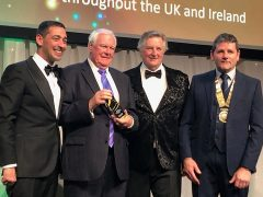 Geoff, second left, with his award