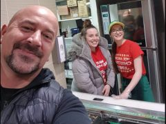 John with Becky (centre) after her act of kindness
