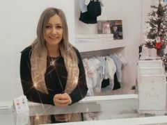 Melissa behind the counter at the boutique
