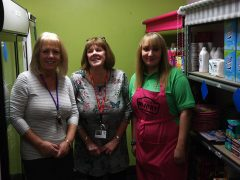 Staff and a volunteer at The Pantry