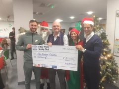 Louis Moult, left, presents the cheque from the Big PNE Sleep Out for £80,000
