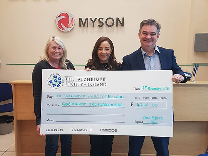 Colleagues with a cheque from a golf day that raised 4,250 Euro for The Alzheimer's Society of Ireland