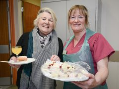 Ward visitor Sarah Guest (left) shares a fruit cocktail with ward housekeeper Christine Ryan on her way to deliver more cocktails and canapes to patients on Rosemere Cancer Centre's Ribblesdale Ward