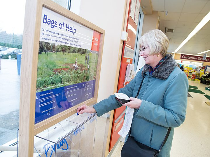 A Tesco customer voting for a local cause
