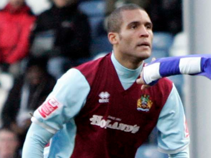 Clarke Carlisle playing for Burnley