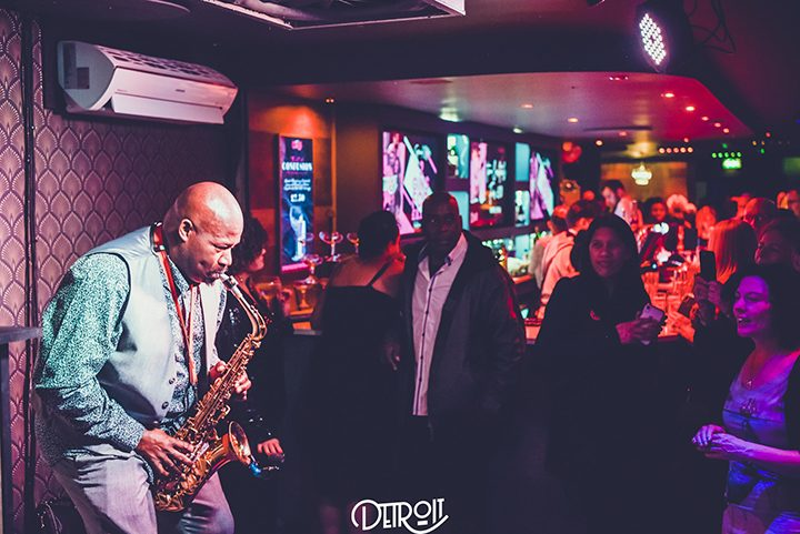 A saxophonist performing at Detroit