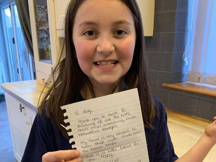 Holly with a thank you note from an NHS worker
