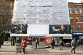 Pop-up exhibition blocks Barclays Bank in Manchester.