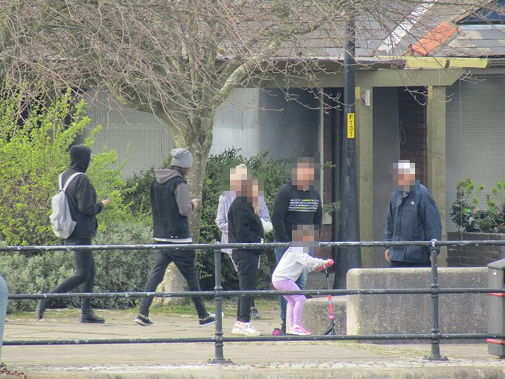 Pedestrians by Preston Dock during lockdown