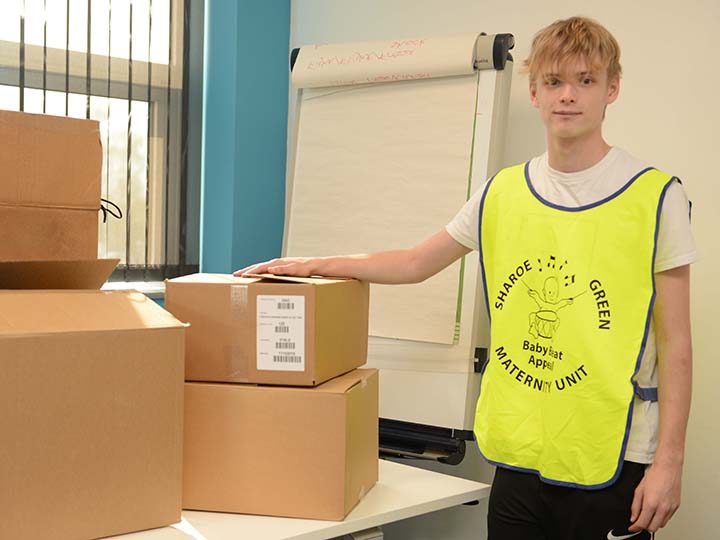 Baby Beat volunteer Laurie Fishwick (18) helps box the bags for delivery to NHS heroes