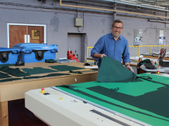 Rob Page, Production Director, cutting scrubs for Preston doctors