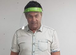 JKN managing director Peter Nicholls wears the protective visor