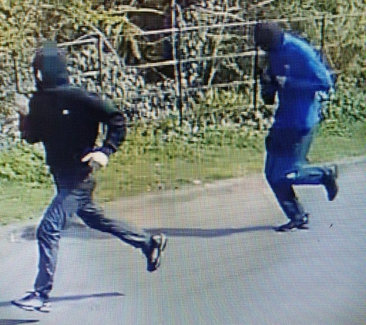 Two hooded young boys seen running from the scene Pic: Preston Police